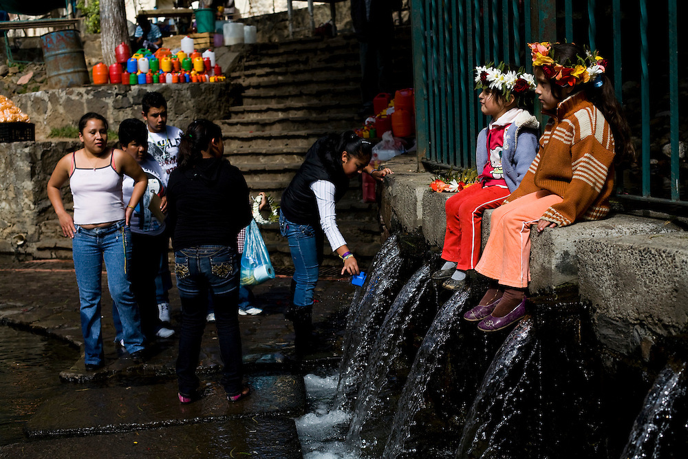 A family washes with holy water in Ahuehuete, the first stop in the holy pilgrimage to Chalma.  It is believed that the water, which springs from underneath an enormous tree, is holy and that one should cleanse with it before arriving at the church in Chalma.
