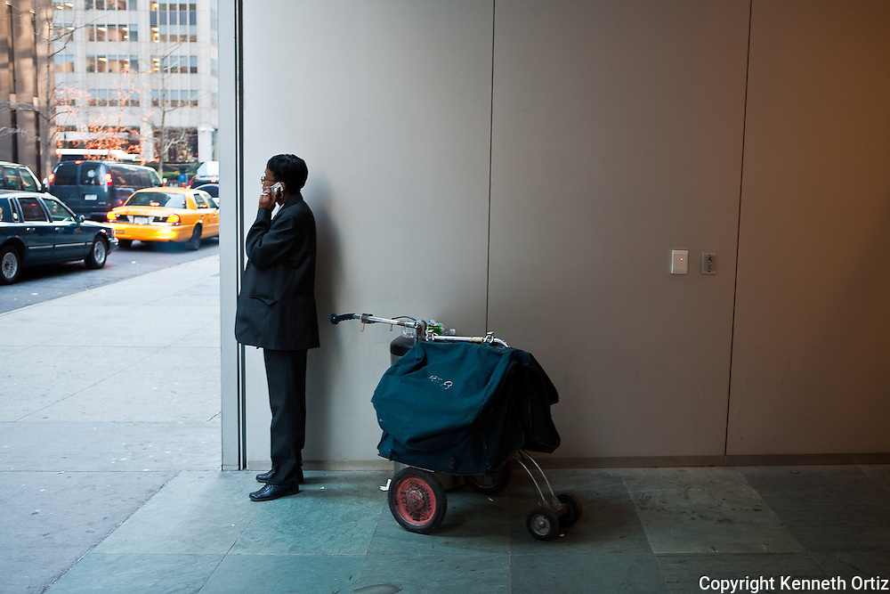 A security guard at the MOMA Museum takes a break to make a phone call.