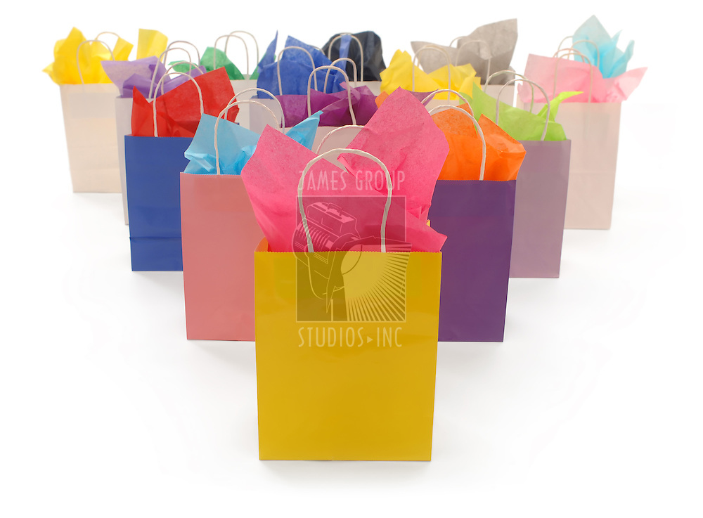 Colorful shopping bags with tissue paper on a white background