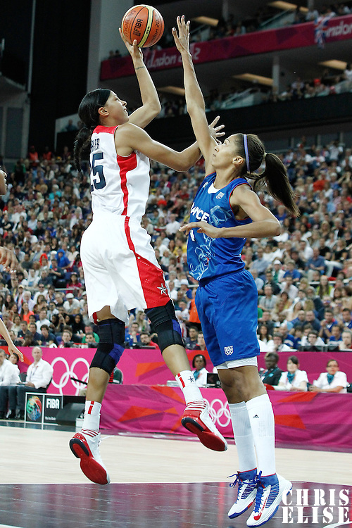 11 August 2012: USA Candace Parker goes for the skyhook over France Sandrine Gruda during 86-50 Team USA victory over Team France, during the Women's Gold Medal Game, at the North Greenwich Arena, in London, Great Britain.