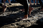 Feet thundered around the first turnaround halfway through the swim portion of Sunday's Ironman competition in Coeur d'Alene as sand quickly turned to soggy mud along the shore...