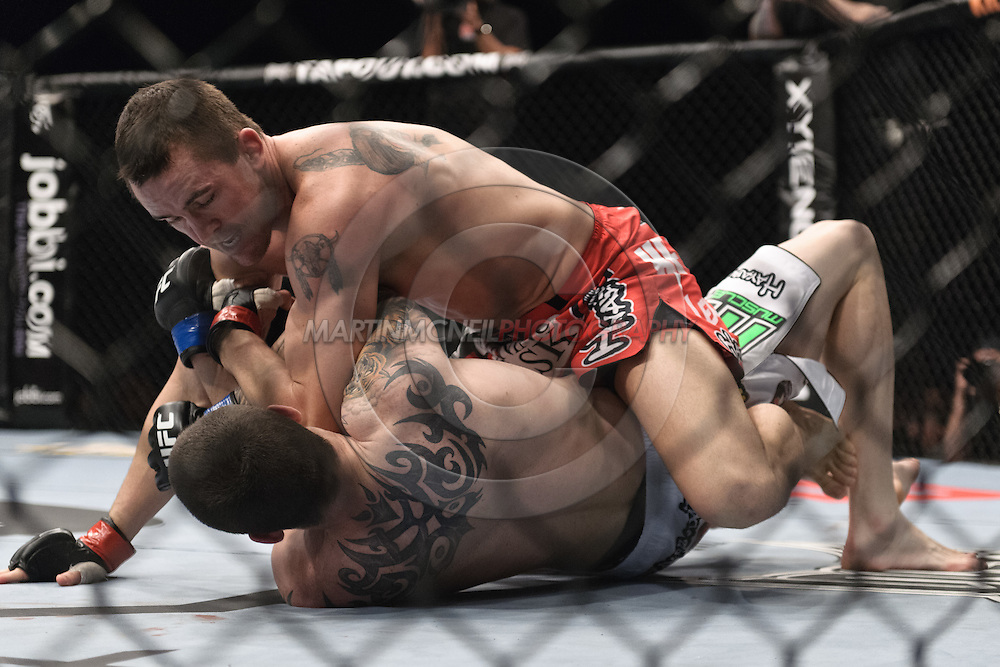 """SYDNEY, AUSTRALIA, FEBRUARY 27, 2011: Kyle Noke (top) lands an elbow strike to the chin of Chris Camozzi during """"UFC 127: Penn vs. Fitch"""" inside Acer Arena in Sydney, Australia on February 27, 2011."""