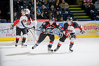 KELOWNA, CANADA, NOVEMBER 23: Tanner Moar #23 of the Kelowna Rockets checks Chase Witala #14 of the Prince George Cougars as the Prince George Cougars visit the Kelowna Rockets  on November 23, 2011 at Prospera Place in Kelowna, British Columbia, Canada (Photo by Marissa Baecker/Shoot the Breeze) *** Local Caption ***