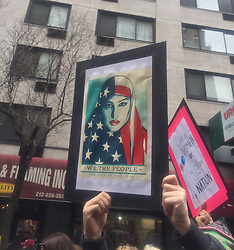 "NEW YORK, USA - Saturday, January 21, 2017: A woman holds up a banner ""We The People are greater than fear"" as thousands of people take part in the Women's March on January 21, 2017 in New York City. The Midtown Manhattan event was one of many anti-Trump protests nationwide that came a day after Donald Trump was sworn in as the 45th President of the United States. (Pic by Concepcion Valadez/Propaganda)"