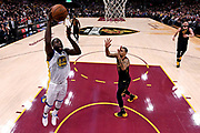 Jun 6, 2018; Cleveland, OH, USA; Golden State Warriors forward Draymond Green (23) shoots the ball against Cleveland Cavaliers guard George Hill (3)  in game three of the 2018 NBA Finals at Quicken Loans Arena.