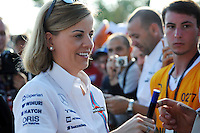 Susie Wolff (GBR) Williams Development Driver signs autographs for the fans.<br /> Italian Grand Prix, Saturday 6th September 2014. Monza Italy.