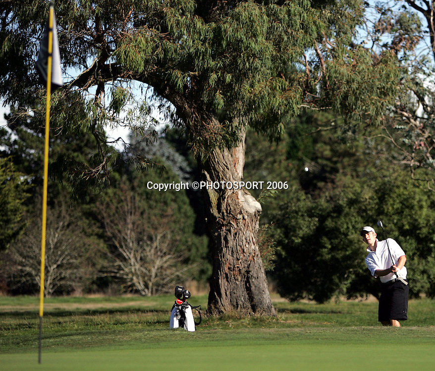 Hamilton's James Gill chips out of a bunker during his match against Australia's Steve Dartnall in the 2006 New Zealand Mens Golf Amateur Championship at Coringa Golf Course, Christchurch, on Saturday 8 April 2006. Gill won the match. Photo: Tim Hales/PHOTOSPORT