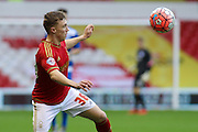 Nottingham Forest midfielder Ben Osborn keeps his eyes on the ball during The FA Cup third round match between Nottingham Forest and Queens Park Rangers at the City Ground, Nottingham, England on 9 January 2016. Photo by Aaron Lupton.