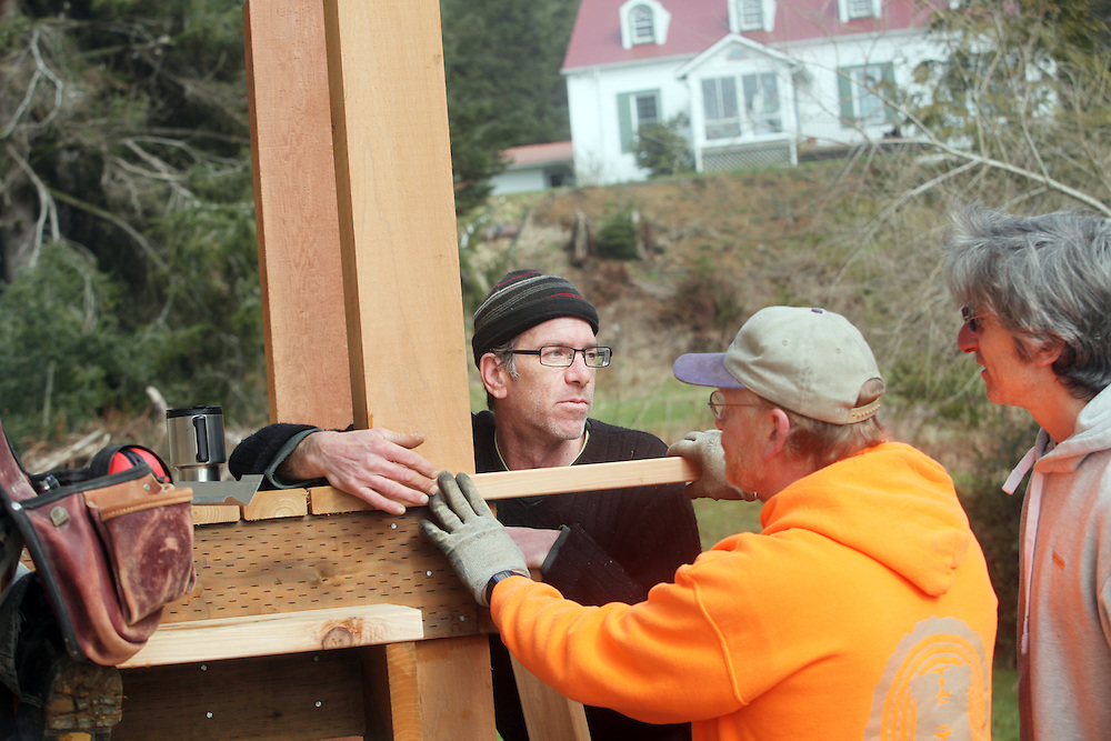 Lucien Swerdloff, right, helps Matt Powers and Allen Vollmer. Clatsop Community College Historic Preservation students, under the supervision of their instructor Lucien Swerdloff and contractor Tim Kennedy, build staircases and railings during a workshop February 5 & 6 to replace the rotted porches on the historic U.S. Columbia River Quarantine Hospital (aka the Pesthouse) in Knappton Cove, Wash., on Sunday, March 6, 2011.