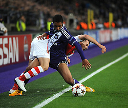 Anderlecht's Youri Tielemans challenges Arsenal's Aaron Ramsey - Photo mandatory by-line: Dougie Allward/JMP - Mobile: 07966 386802 - 22/10/2014 - SPORT - Football - Anderlecht - Constant Vanden Stockstadion - R.S.C. Anderlecht v Arsenal - UEFA Champions League - Group D