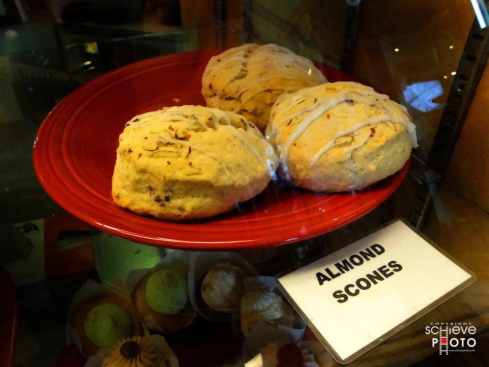 Almond scones on red plate.
