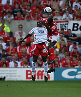 Photo: Rich Eaton. <br /> <br /> Nottingham Forest v AFC Bournemouth. Coca Cola Championship. 11/08/2007. Forest's Wes Morgan (r) leaps ahead of Jo Kuffour of Bournemouth.