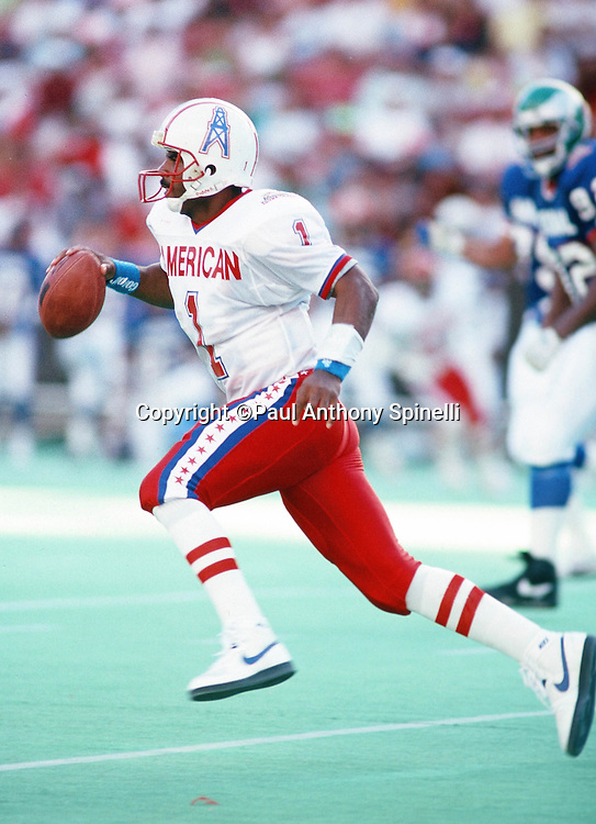 Houston Oilers quarterback Warren Moon (1) runs the ball during the 1990 NFL Pro Bowl between the National Football Conference and the American Football Conference on Feb. 4, 1990 in Honolulu. The NFC won the game 27-21. (©Paul Anthony Spinelli)