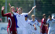 SO Slovakia (white) compete with SO Latvia (red) during the 2013 Special Olympics European Unified Football Tournament in Warsaw, Poland.<br /> <br /> Poland, Warsaw, June 06, 2012<br /> <br /> Picture also available in RAW (NEF) or TIFF format on special request.<br /> <br /> For editorial use only. Any commercial or promotional use requires permission.<br /> <br /> <br /> Mandatory credit:<br /> Photo by © Adam Nurkiewicz / Mediasport