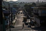 A woman walks in the lazy streets of Eldorado town, south of Sao Paulo, Brazil, Tuesday, Nov. 27, 2018. (Dado Galdieri)