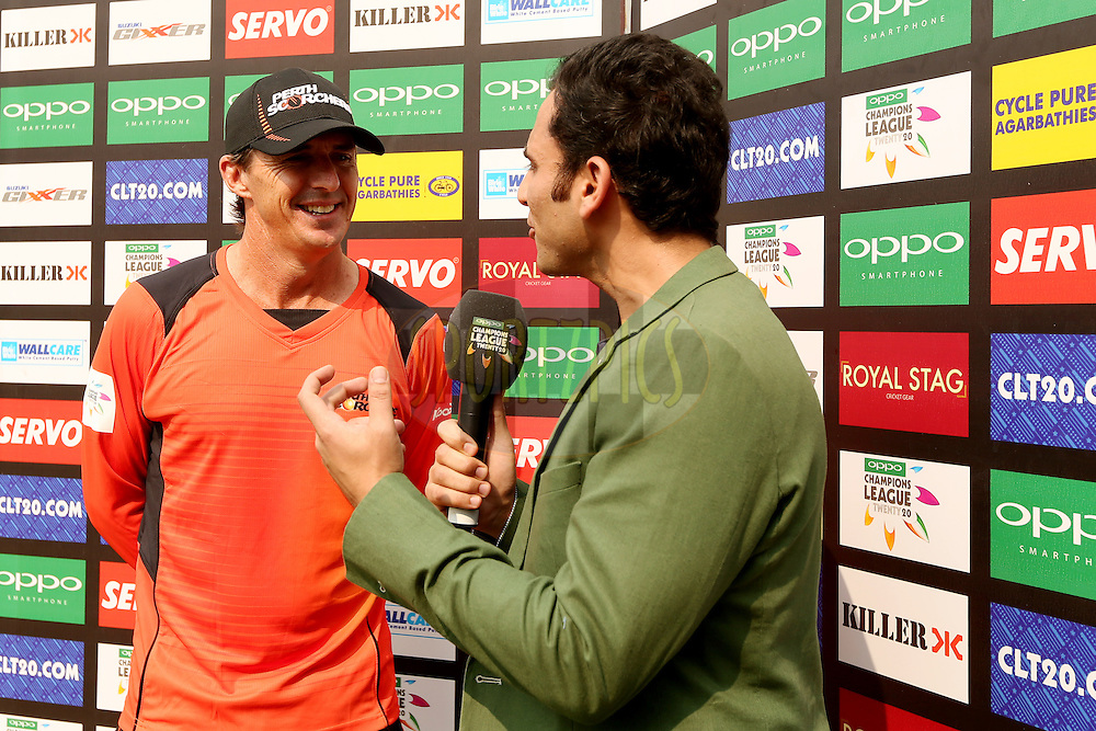 Brad Hogg during a television interview before the start of match 4 of the Oppo Champions League Twenty20 between the Dolphins and the Perth Scorchers held at the Punjab Cricket Association Stadium, Mohali, India on the 20th September 2014. Photo by:  Jacques Rossouw / Sportzpics/ CLT20<br /> <br /> <br /> Image use is subject to the terms and conditions as laid out by the BCCI/ CLT20.  The terms and conditions can be downloaded here:<br /> <br /> http://sportzpics.photoshelter.com/gallery/CLT20-Image-Terms-and-Conditions-2014/G0000IfNJn535VPU/C0000QhhKadWcjYs