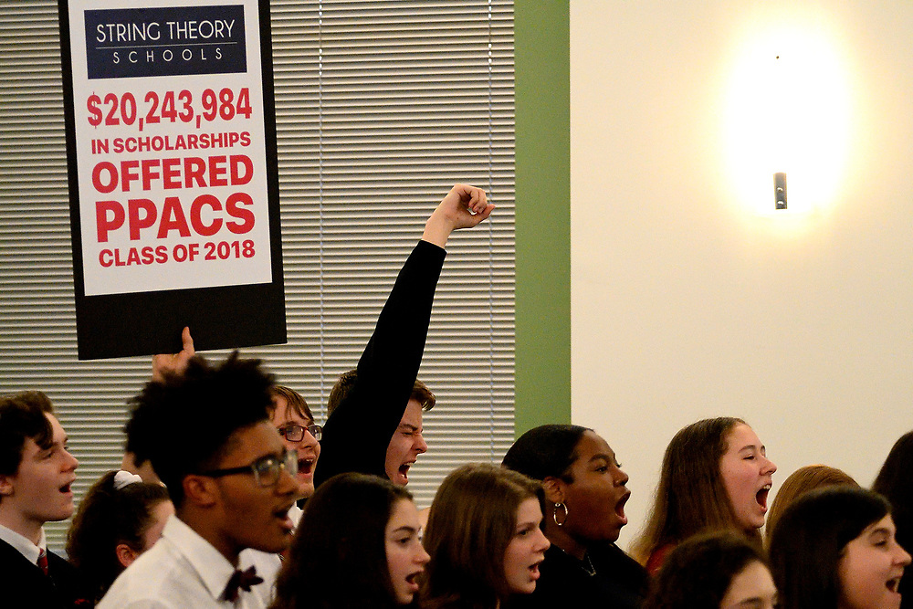 Students hold up protest signs during the Board of Education's monthly meeting at the School District of Philadelphia Headquarters, on February 28, 2019. (Bastiaan Slabbers for WHYY)