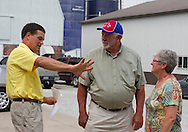 Tom Dittmer (from left) talks with Glen and Jean Keppy, of Davenport, at Grandview Farms in Eldridge, Iowa on Thursday August 9, 2012.