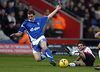 Photo: Jonathan Butler.<br />Southampton v Ipswich Town. Coca Cola Championship. 24/02/2007.<br />Alex Bruce of Ipswich is tackled by Andrew Surman of Southampton.