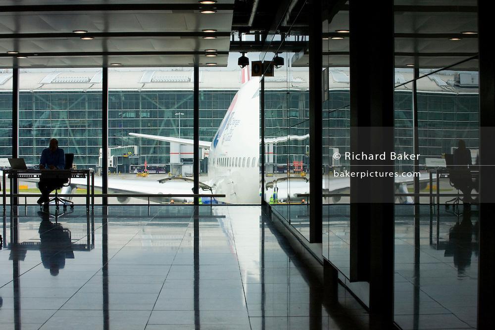 Heathrow writer-in-residence, Alain de Botton writes his airport novel near 747 in Departures at Heathrow Airport's Terminal 5.