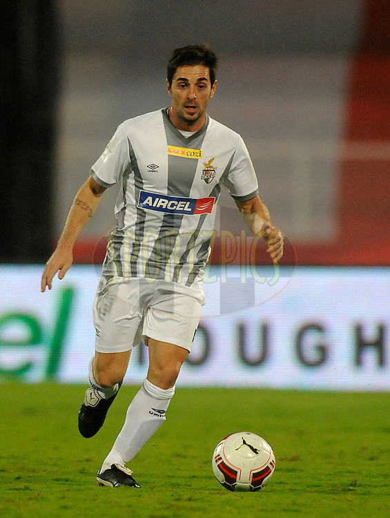 Joffre Mateu Gonzalez of Atletico de Kolkata during match 44 of the Hero Indian Super League between FC Pune City and Atletico de Kolkata FC held at the Shree Shiv Chhatrapati Sports Complex Stadium, Pune, India on the 29th November 2014.<br /> <br /> Photo by:  Pal Pillai/ ISL/ SPORTZPICS