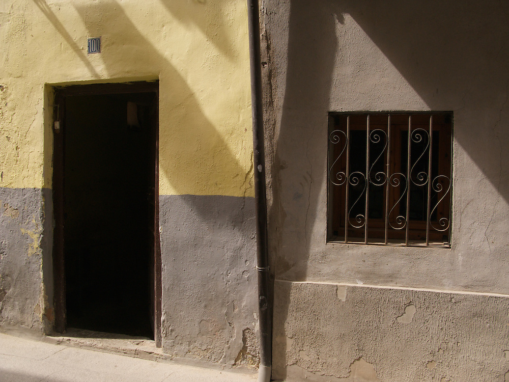 Colourful door and window in the town of Santa Domingo de la Calzada. Evening light.