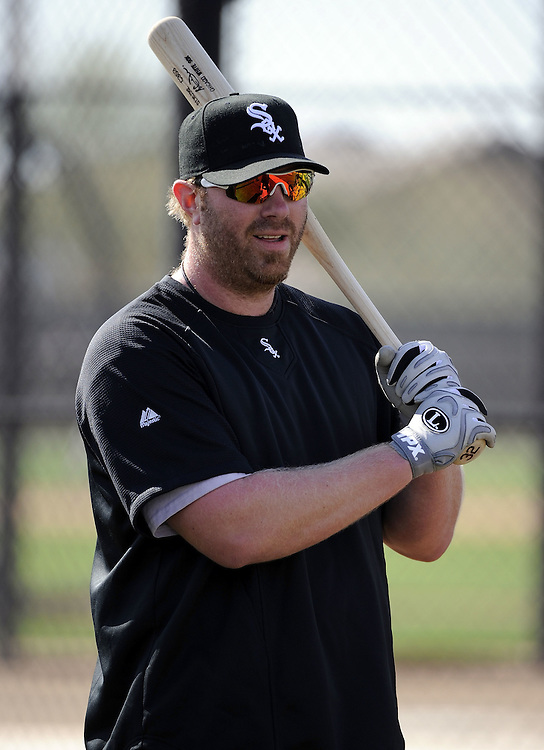 GLENDALE, AZ - FEBRUARY 25:  Adam Dunn #32 of the Chicago White Sox looks on during a spring training workout on February 25, 2011 at Camelback Ranch in Glendale, Arizona. (Photo by Ron Vesely)