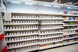 © Licensed to London News Pictures. 05/03/2020. London, UK. Completely empty shelves on the hand sanitiser aisle. Panic-buying continues to show in a South West London ASDA store as shelves empty out of goods as Prime Minister Boris Johnson appears on This Morning TV show to reassure the public that the Government is doing all it can to fight the coronavirus disease.. Photo credit: Alex Lentati/LNP