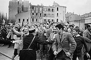 1960.Marseille,<br /> A friendly crowd of French communists<br /> breaks through security causing major<br /> panic with Khrushchev's security men<br /> as they were not prepared for a joyous outpouring such as this. They rushed Khruschev in the first car they could find and was send off. <br /> NOTE: The Russian journalists and photographers who were with us, turned around and acted as temporary bodyguards,a very unusual <br /> happening.<br /> <br /> 1960. Marseille, France<br /> Une foule amicale des communistes fran&ccedil;ais perce la s&eacute;curit&eacute; causant une<br /> panique chez les hommes de la s&eacute;curit&eacute; de Khrouchtchev, mal pr&eacute;par&eacute;s pour une effusion de joie comme celle-ci . Ils ont pr&eacute;cipit&eacute;s Khruschev dans la premi&egrave;re voiture qu'ils ont pu trouver sont partis. <br /> NOTE : Les journalistes russes et les photographes qui &eacute;taient avec nous , se sont retournes et ont agis comme gardes du corps temporaires, une fonction tr&egrave;s inhabituel pour eux.