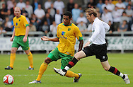 Dartford - Saturday July 11 2009: John Ostemobor of Norwich City and Jamie Day of Dartford during the friendly match at Princes Park. (Pic by Alex Broadway/Focus Images)..