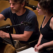 June 3, 2014 - New York, NY : Composer Julia Adolphe, right, works with mentor composer Steven Mackey during a rehearsal of Adolphe's composition by the New York Philharmonic at Avery Fisher Hall on Tuesday. Three works by little-known composers, such as Adolphe, will be selected for inclusion in the New York Philharmonic's Biennial. CREDIT: Karsten Moran for The New York Times