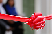 A red ribbon stretches across the entrance of Adobe Alviso Park during the park's opening ceremony at Alviso Adobe Park in Milpitas, California, on March 16, 2013. (Stan Olszewski/SOSKIphoto)