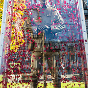 First World War sculpture unveiled in George Square, Glasgow as part of Scottish Poppy Appeal. The 23ft travelling statue Every Man Remembered depicts a figure in brass of the Unknown Soldier standing on a block of limestone from the Somme area of France. It is encased in a glass box with hundreds of poppies floating around it. This is the first time it has been unveiled in Scotland.  Picture Robert Perry 1st Nov 2016<br /> <br /> Must credit photo to Robert Perry<br /> FEE PAYABLE FOR REPRO USE<br /> FEE PAYABLE FOR ALL INTERNET USE<br /> www.robertperry.co.uk<br /> NB -This image is not to be distributed without the prior consent of the copyright holder.<br /> in using this image you agree to abide by terms and conditions as stated in this caption.<br /> All monies payable to Robert Perry<br /> <br /> (PLEASE DO NOT REMOVE THIS CAPTION)<br /> This image is intended for Editorial use (e.g. news). Any commercial or promotional use requires additional clearance. <br /> Copyright 2014 All rights protected.<br /> first use only<br /> contact details<br /> Robert Perry     <br /> 07702 631 477<br /> robertperryphotos@gmail.com<br /> no internet usage without prior consent.         <br /> Robert Perry reserves the right to pursue unauthorised use of this image . If you violate my intellectual property you may be liable for  damages, loss of income, and profits you derive from the use of this image.