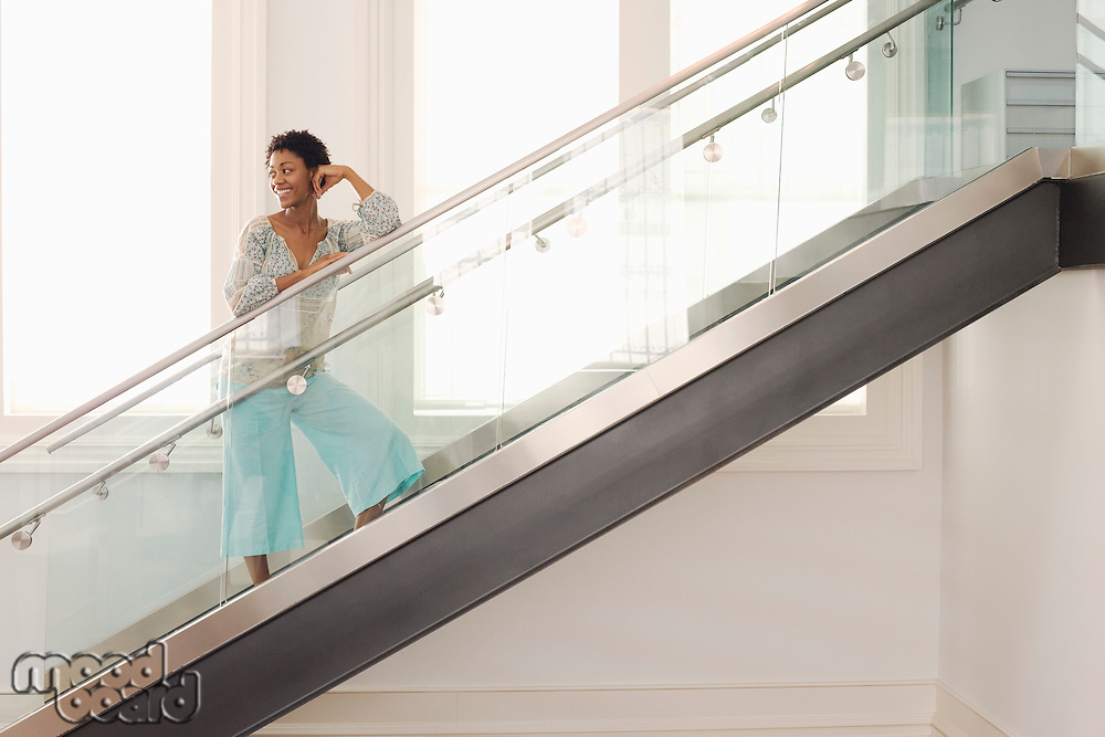 Mid-adult woman on stairs