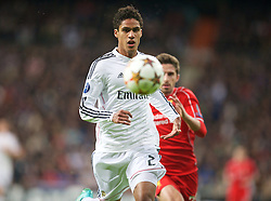 MADRID, SPAIN - Tuesday, November 4, 2014: Real Madrid's Raphael Varane in action against Liverpool during the UEFA Champions League Group B match at the Estadio Santiago Bernabeu. (Pic by David Rawcliffe/Propaganda)