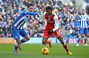 Brighton's Biram Kayal battles with Birmingham City's Demarai Gray during the Sky Bet Championship match between Brighton and Hove Albion and Birmingham City at the American Express Community Stadium, Brighton and Hove, England on 21 February 2015. Photo by Phil Duncan.