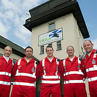 SCAA..Scotland's Charity Air Ambulance Paramedics from left, John Pritchard, Alex Holden, Wayne Auten, Andy Walker and Bruce Rumgay<br /> The helicopter is a Bolkow 105 supplied by Bond Aviation Services.<br /> Picture by Graeme Hart.<br /> Copyright Perthshire Picture Agency<br /> Tel: 01738 623350  Mobile: 07990 594431