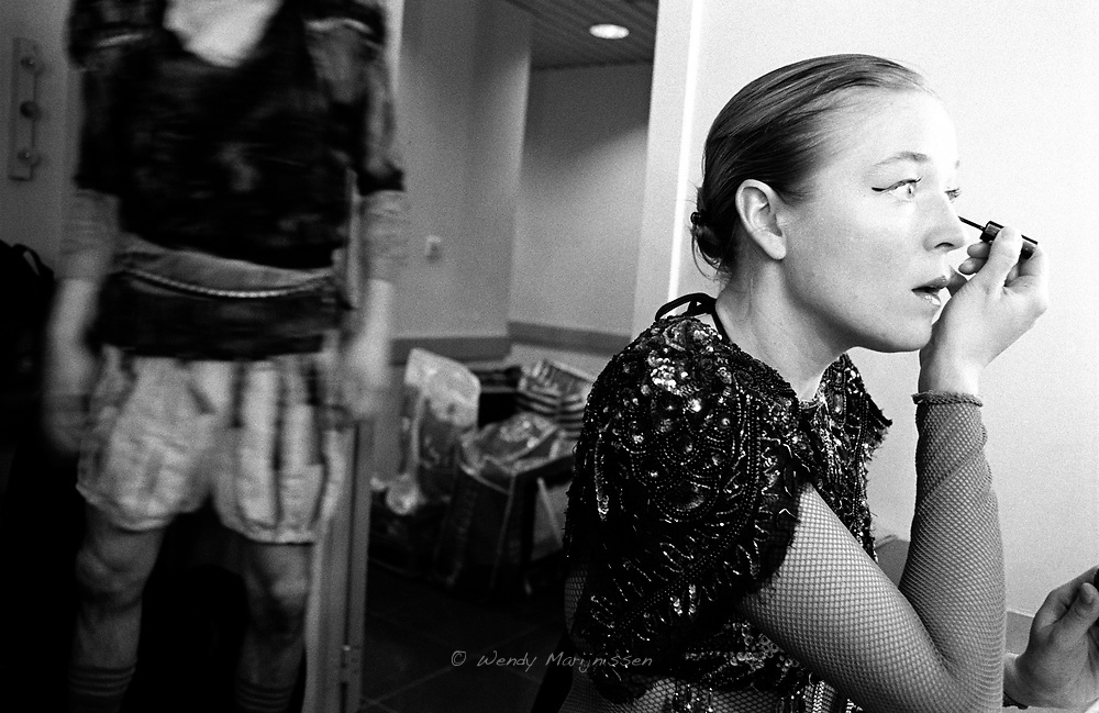 Arianne, one of the professional actors that joins in to collaborate with Theater Stap, putting on make-up before the Donkisjot performance. Brussels, Belgium, 2006