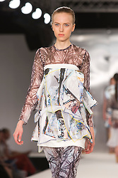 © Licensed to London News Pictures. 02/06/2014. London, England. De Montfort University Leicester, collection by Yasemin Chin. Graduate Fashion Week 2014, Runway Show at the Old Truman Brewery in London, United Kingdom. Photo credit: Bettina Strenske/LNP