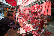 Hong Kong. Central street market. Butcher.