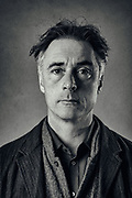 "Greg Wise, the actor, photographed in the Guardian Studios in London.  Wise co wrote a book ""Not That Kind Of Love"" with his sister Clare Wise.  Clare was diagnosed with cancer in 2013 and started writing a blog that chronicled the last 3 years of her life. When she could no longer type, Greg took over and continued the blog until her death and created the book after.  Greg Wise is an English actor and producer. He has appeared in many British television works, as well as several feature films (notably the role of John Willoughby in Sense and Sensibility)."