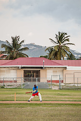 Hugh Reifer takes a swing.  Players of the 40 and over cricket team practice for an upcoming tournament at Addelita Cancryn field.  St. Thomas, USVI.  14 April 2015.  © Aisha-Zakiya Boyd