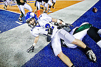 Coeur d'Alene High's Joe Roletto gets pulled out of bounds by an Eagle defender just short of the goal line after an one of his three interceptions in the championship game.