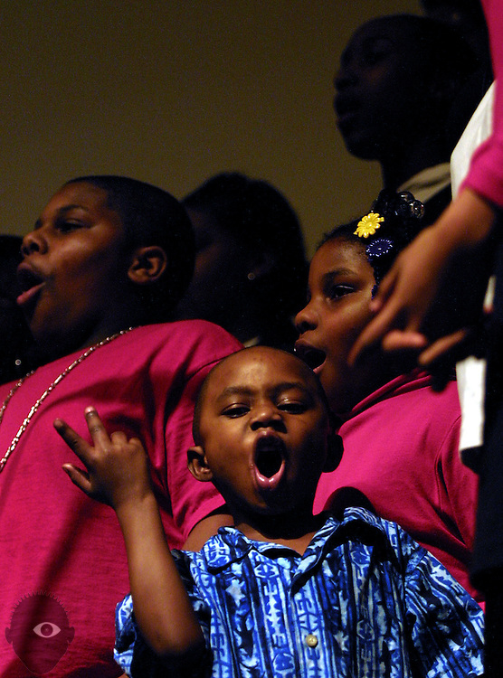 Tajamar Hepburn (center) , 4, and Bendrea Andrews (left) ,13, sing joyfully with other members of the Portland Metropolitan Youth Choir.  They join many other groups at the 18th Annual Gospel Music Extravaganza at the New Song Community Church.