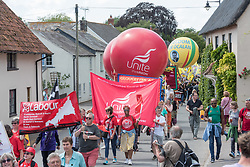 © Licensed to London News Pictures. 21/07/2019; Tolpuddle, Dorset, UK. The parade of trades unions through the village of Tolpuddle, part of the Tolpuddle Martyrs Festival which Jeremy Corbyn is attending this year. The Tolpuddle Martyrs Festival for trade unionism, held every year, commemorates the birth of the trade union movement in the 19th century when the Tolpuddle Martyrs were transported to Australia for forming a trade union of agricultural labourers in Dorset. Photo credit: Simon Chapman/LNP.