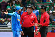 Virat Kohli (captain) of India argues with the umpires after an lbw review was lost during the ICC Cricket World Cup 2019 match between Bangladesh and India at Edgbaston, Birmingham, United Kingdom on 2 July 2019.