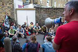 London, UK. 18 July, 2019. Climate activists from Extinction Rebellion hold a Heathrow expansion consultation outside the venue for Heathrow's 'masterplan' consultation event in Lambeth after the venue was closed to the public half an hour before the scheduled time following an earlier peaceful, non-violent protest by Extinction Rebellion against plans for a third runway at Heathrow airport.