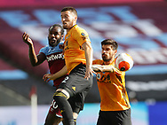 Michail Antonio of West Ham United challenged by Matt Doherty and Ruben Neves of Wolverhampton Wanderers during the Premier League match at the London Stadium, London. Picture date: 20th June 2020. Picture credit should read: David Klein/Sportimage