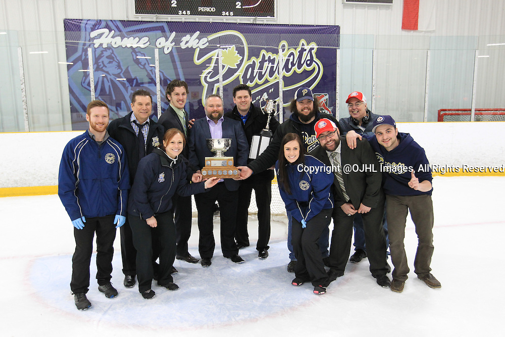 TORONTO, ON - Apr 22, 2015 : Ontario Junior Hockey League game action between the Toronto Patriots and the Kingston Voyageurs. Game seven of the Buckland Cup Championship Series. Patriots staff pose with the cup.<br /> (Photo by Tim Bates / OJHL Images)