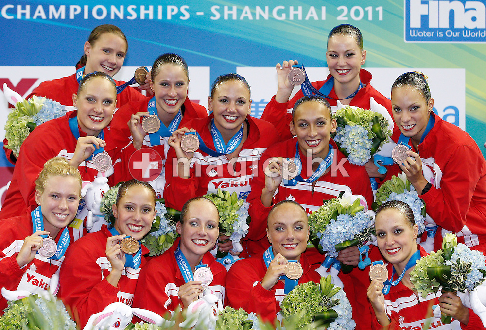 Members of team Canada pose with their Bronze medals after finishing third in the Synchronized (synchronised) Swimming Team Free Combination final during the 14th FINA World Aquatics Championships at the Oriental Sports Center in Shanghai, China, Thursday, July 21, 2011. (Photo by Patrick B. Kraemer / MAGICPBK)